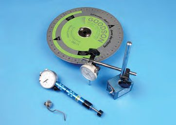 Pictured here is a Goodson degree wheel, a dial indicator with adjustable stand, a homemade wire pointer, and a Foster lifter gauge.