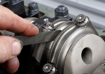Never assume that rod side clearance is correct, whether you're dealing with new or used cranks and/or rods. Always check side clearance by inserting a clean feeler gauge between the two rod big ends. Be sure to pull the rods apart by hand while inserting the gauge. Always refer to side clearance specifications for the engine at hand, but in general terms, you should have at least .012 inch or so clearance.
