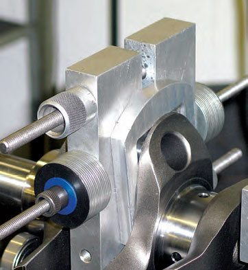 Shown here is a spacer inserted on one side of a bobweight. With the bobweight pushed up against the spacer, the bobweight's halves are secured together, and then the spacer is removed.