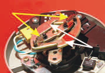 The RPM-induced advance, often referred to as mechanical advance, is tailored to suit the engine's requirements by spring selection (yellow arrows) and the shape and mass of weights (white arrows).
