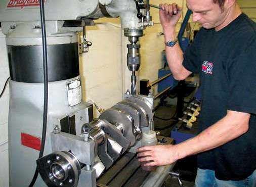 When weight must be removed from a crank counterweight, it is done on an overhead drill press. Some balancing machines incorporate a drill while a separate drill press is required for other systems.