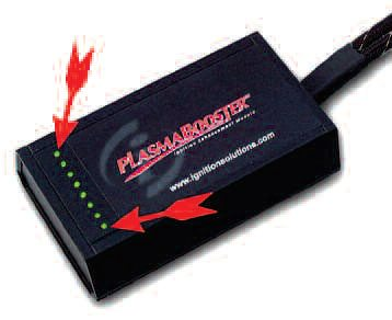 The Ignition Solutions plasmagenerating box has LEDs (arrows) that indicate each cylinder is receiving the plasma output.