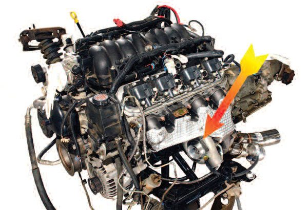 Here is an example of a twin-turbo system from Air Power Systems in Australia. As indicated by the arrow, the turbos are situated low and on either side of the engine. This install requires a tubular subframe to make everything fit. Although an extra cost is involved with the subframe, cutting some 70 pounds from the front helps reduce the inevitable traction problems that big power numbers bring about.