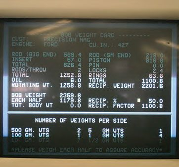 The monitor on this balancer's screen displays all of the weight data input by the technician.
