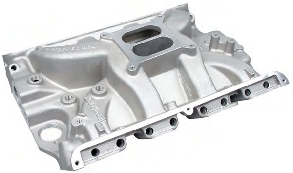 Example of a dual-plane manifold for the Ford FE engine. Note the pushrod holes.