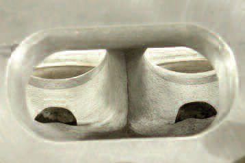 On most four-valve heads, the port dividers are rounded at the leading edge because a cast sharp edge is not very practical to do. By knife-edging the divider as seen here, measurable extra flow can be found for minimal effort.