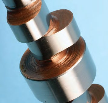 While flat-tappets have a narrower radius at the peak of the lobe, roller cams require a large-radius lobe peak to maintain full lifter roller contact with the lobe. If the lobe had a narrow (small) radius, the roller jumps and chatters as it rides past the peak. Roller lifters need a nice, flat surface to continually ride on the lobe. One advantage of roller cams/lifters (in addition to reduced friction) is that rollers hold the lifter at max lift for a longer duration, which helps to load the cylinder with more air/fuel.