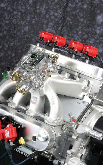 Converting a GM LS engine to old-school carburetion is embarrassingly simple, requiring only a manifold, carb, and an MSD ignition controller. No ECM required.