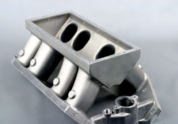 Some tunnel ram intake manifolds, such as this one from Pro-Filer, have a modular plenum top. This not only gives you a choice between using a single or dual carb setup, but the open access makes it very easy to inspect for port matching to the cylinder heads.