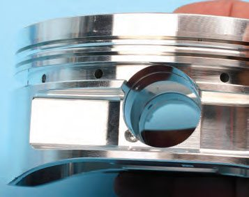 Notice the shallow radiused groove (accumulator groove) between the top and second ring lands. This provides a small volume area for combustion pressure that sneaks past the top ring and reduces second ring flutter.