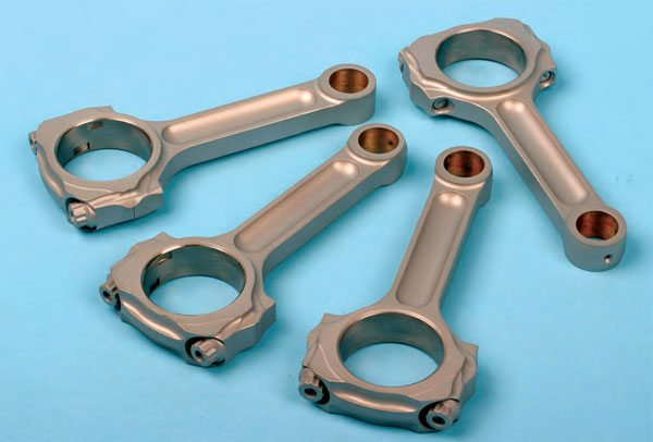 An oil-shedding coating applied to connecting rods serves the same purpose: to reduce parasitic power loss caused by unwanted oil clinging to the surfaces. After all, the engine doesn't need oil on the exterior surfaces of the crank and rods for lubrication, so by promoting oil departure from these surfaces, we reduce unnecessary drag, which helps to free-up horsepower from the rotating assembly.