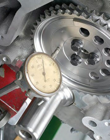 Before attaching the timing chain (or belt), always check camshaft endplay with a dial indicator. Generally, endplay should be somewhere in the range of approximately .003 to .006 inch.