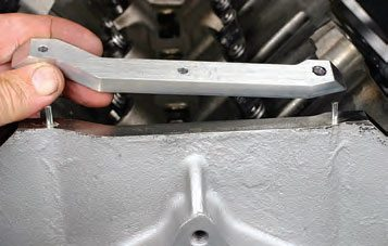 Installing locating pins ensures that the spacer installs at the correct location, and that the spacer can't accidentally move during assembly or during engine operation.