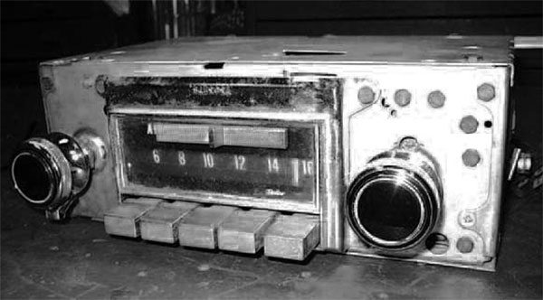 Here's our traditional before picture of the radio that we're converting to digital. It's a typical mid- 1960s Chevrolet AM/FM push-button radio with only a tone dial and no provision for balance or fade control. We'll add the latter two, along with four-channel sound and the ability to play external devices, such as CD or MP3 players.