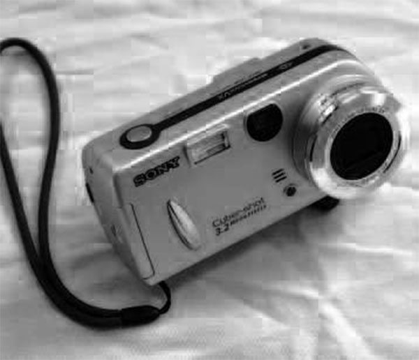A typical point-and-shoot digital camera will help you document the disassembly process so you're not finding yourself scratching your head when it comes time to reassemble everything. Look for one with a few more megapixels than the older camera pictured.
