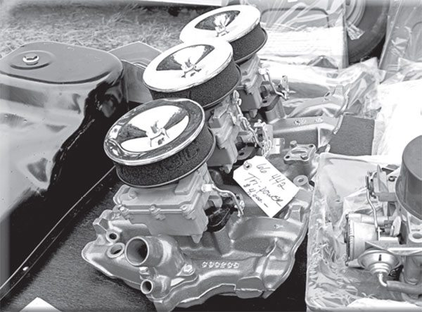 All Olds Tri-Carb units are not created equal. J-2 stuff from the 1950s is valued, but follows far behind the $4,000 needed to score this 1966- only Tri-Carb assembly.