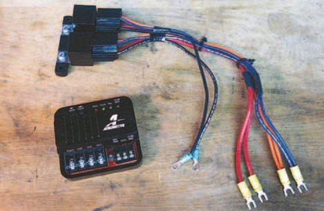 Fig. 4.12. The Aeromotive FPSC is about the same size as the pair of 40-amp relays it replaces. The similarities end there. This is one smart little box. Installation is not much more difficult than connecting the pair of relays that originally powered the fuel pump.
