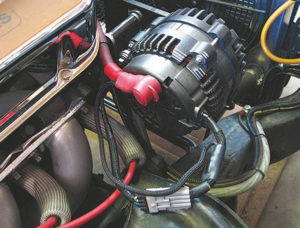 Fig. 4.24. The Mechman Adjustable Voltage Boost Module plugged right in to the existing Iraggi alternator. I elected to extend and loom the sense lead to make the install neat and tidy. For now, I left the adjustment easily accessible.