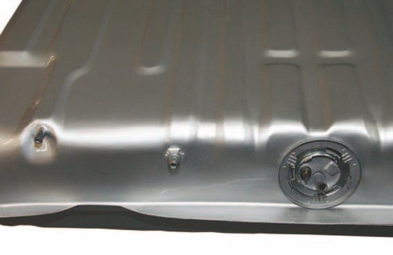 Fig. 5.15. Keith added a -6 male fitting to the Impala Bob's stock replacement fuel tank to facilitate a return-style fuel system. (Photo Courtesy Keith Kanak)