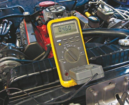 Fig. 5.45. I used my trusty Fluke 87 DMM and PV350 pressure/vacuum transducer to set the fuel pressure via the fuel pressure gauge port on the Holley regulator. The Fluke PV350 connects to the regulator in the same way as any standard gauge and provides incredibly accurate readings. MSD recommends between 42 and 48 psi, so we set it at 46 psi.