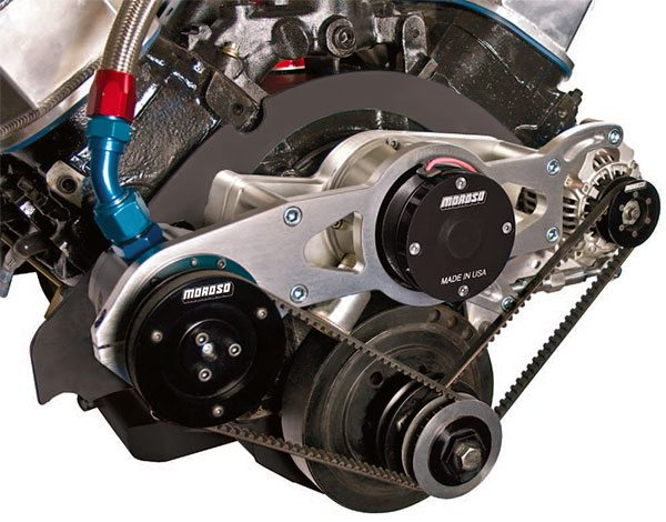 Drive systems vary con¬siderably depending on the application. Most manufacturers have auxiliary hardware such as this water pump mounting plate for a Moroso alternator and vacuum pump. Appro¬priate-drive mandrel components are also required to properly position the drive belts.