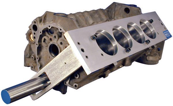 Precise cylinder bore alignment in relation to the crankshaft centerline is a fundamental step in basic cylinder block prepara¬tion. BHJ's block truing alignment fixture helps machinists position each deck exactly 90 degrees from the other and perfectly perpendicular to the crankshaft. (Courtesy BHJ Products)